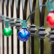 25' Commercial Multicolor Satin Patio String Light Set with 25 G50 Bulbs on Green Wire, E12 Base
