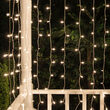 Clear Mini Curtain Icicle Lights on White Wire