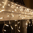 70 Warm White Twinkle M5 LED Icicle Lights on White Wire