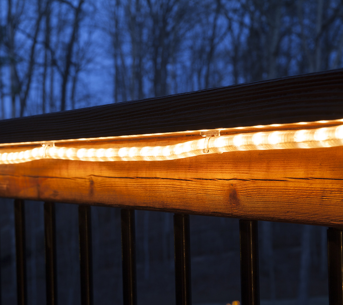 Rope Light Mounted Under a Deck Railing